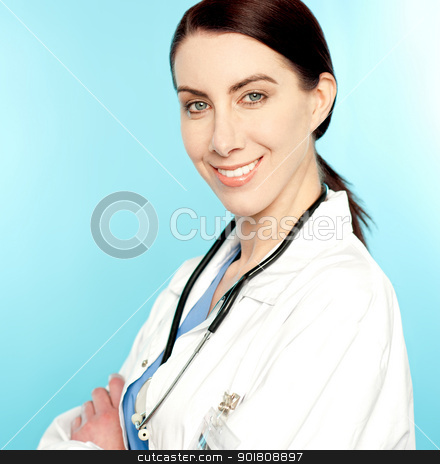 Closeup portrait of charming female doctor stock photo, Closeup portrait of charming female doctor with stethoscope around her neck by Ishay Botbol