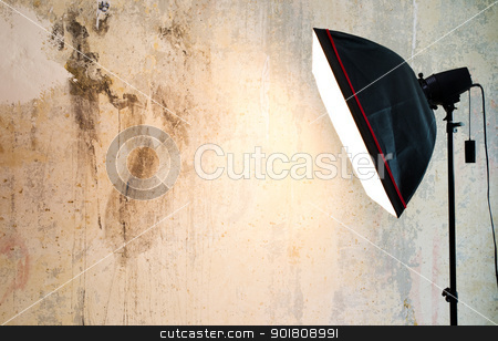 Empty background inside photo studio stock photo, Closeup fragment of grunge weathered wall with lighting lamp by Imaster