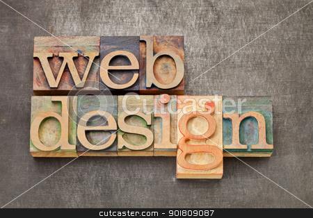 web design stock photo, web design - text in vintage letterpress printing blocks against a grunge metal sheet by Marek Uliasz