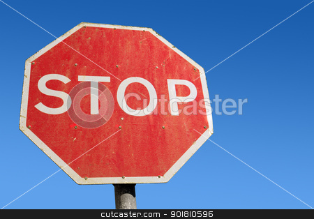 Dirty old red British Stop sign and blue sky. stock photo, Dirty old red British Stop sign and blue sky. by Stephen Rees