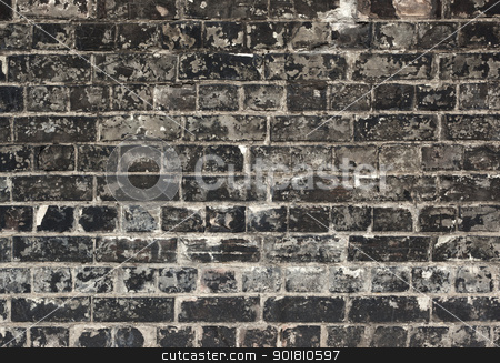 Old weathered black brick wall texture close up. stock photo, Old weathered black brick wall texture close up. by Stephen Rees