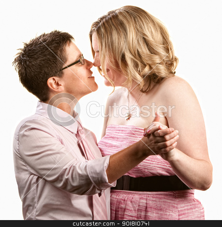 Lesbian Couple Dancing stock photo, Two lesbian women dancing together over white background by Scott Griessel