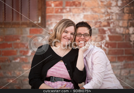 Lesbian Couple Outdoors stock photo, Lesbian couple sitting next to each other outdoors by Scott Griessel