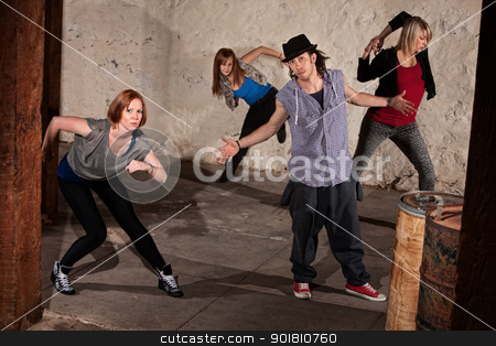 Cool Hip Hop Dancers stock photo, Cool urban dancers posing in underground setting by Scott Griessel