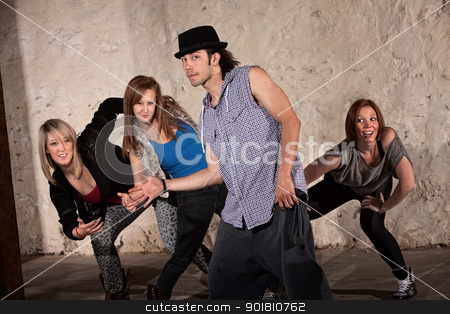 Four Cool Hip Hop Dancers stock photo, Cool young Hispanic dancer with group in underground setting by Scott Griessel