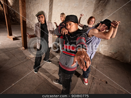 Mexcian Break Dancer with Group stock photo, Cool Mexican break dancers in underground setting by Scott Griessel