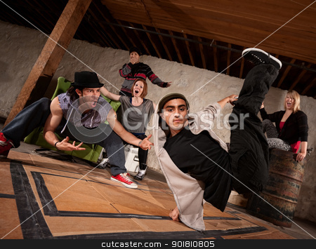 Break Dancers Performing stock photo, Cool South Asian teenager break dacing with friends by Scott Griessel