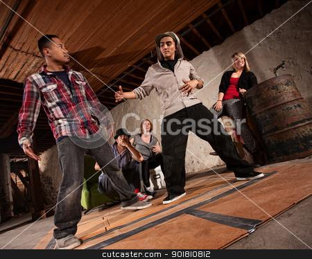 Break Dancing Battle stock photo, Two handsome Latino men face off in break dancing battle by Scott Griessel