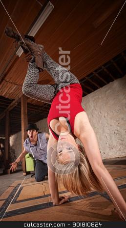 Female Dancer in Hand Stand stock photo, Attractive young European break dancer standing on her hands by Scott Griessel