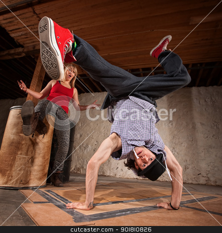 Break Dancer Does Upside Down Kick stock photo, Flexible young Mexican break dancer with impressed friend by Scott Griessel