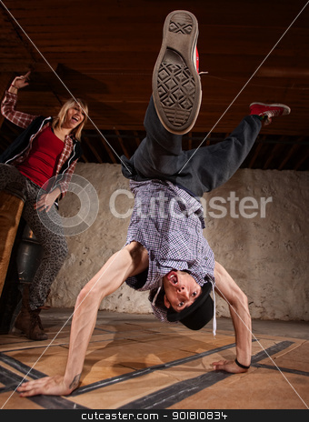 Hand Stand Break Dance Move stock photo, Young woman cheers on man doing freestyle hand stands by Scott Griessel