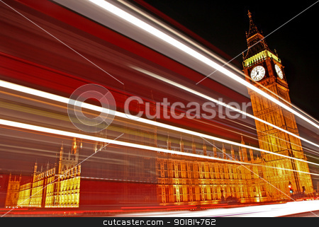 Light Trails Passing the Houses of Parliament. stock photo, The light trails of a London bus passing the Houses of Parliament. by Chris Dorney