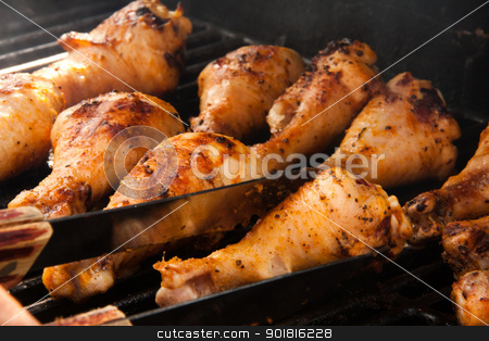 Delicious Barbeque Drumsticks stock photo, Chicken drumsticks on the grill by Rachel Duchesne