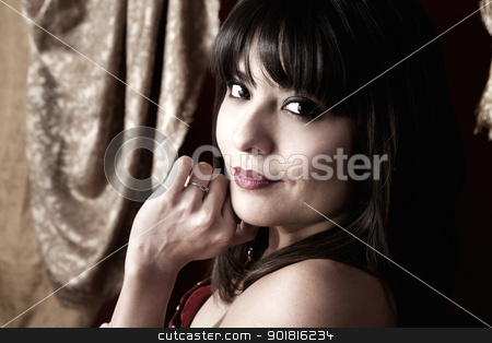 Gorgeous Belly Dancer stock photo, Gorgeous Belly Dancer with hand on chin by Scott Griessel