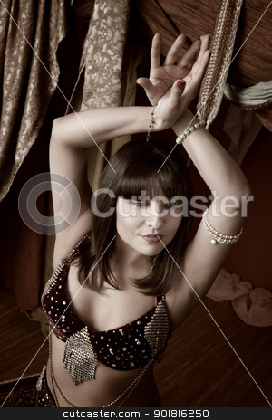 Gorgeous Belly Dancer stock photo, Gorgeous Arab belly dancer with hands crossed above her head by Scott Griessel