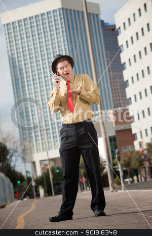 Surprised Businessman On Phone Call stock photo, Surprised Caucasian business on phone call with open mouth by Scott Griessel