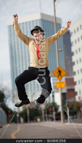 Businessman Jumps In The Air stock photo, Happy Caucasian businessman jumps in the air  by Scott Griessel