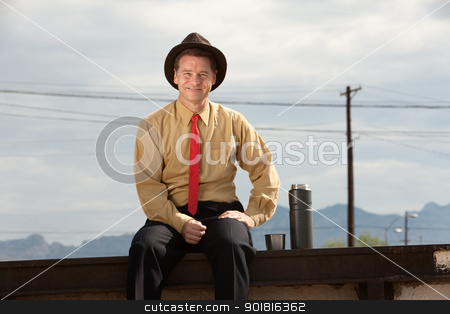 Businessman Relaxes stock photo, Smiling Caucasian businessman with hand on thigh by Scott Griessel