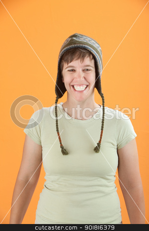 Grinning Girl stock photo, Young Caucasian woman in cap grinning from ear to ear by Scott Griessel