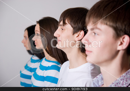 Group of casual people in a row stock photo, Group of casual people in a row on a light background by Vadim
