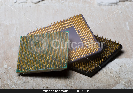 Old processors stock photo, Old processors lying on an old surface by Vadim