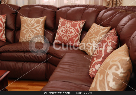 pillows on a leather sofa stock photo, pillows on a brown leather sofa by Vadim