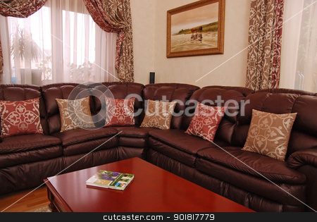 pillows on a leather sofa stock photo, pillows on a leather sofa and a picture on a wall by Vadim