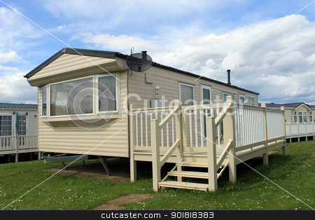 Mobile caravans or trailers in modern holiday park stock photo, Mobile caravans or trailers in modern holiday park  by Martin Crowdy