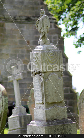Old gravestone in cemetery stock photo, Old gravestone in cemetary with church in background. by Martin Crowdy