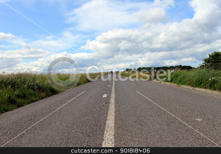 Road in countryside stock photo, Road in in countryside under cloudscape with two unidentifiable hikers in background. by Martin Crowdy