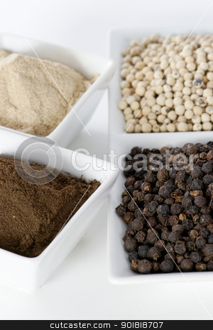 Black and white pepper grain and powder stock photo, Black and white pepper grain and powder in ceramic bowl  by pixs4u