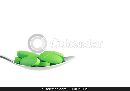Green tablet on the spoon stock photo, Green tablet on the spoon by jakgree
