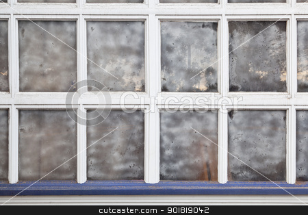 old multi panel window stock photo, old grunge multi panel window with street reflection by Marek Uliasz