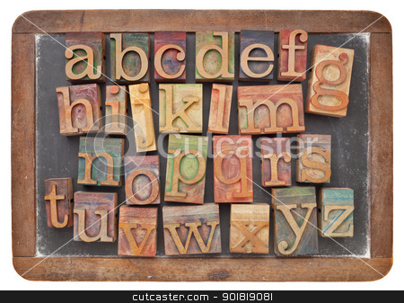 letterpress alphabet on balckboard stock photo, English alphabet in vintage letterpress wood type on an old slate blackboard by Marek Uliasz