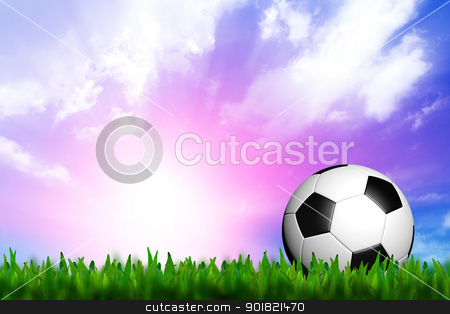 football in green grass over a twilight sky stock photo, football in green grass over a twilight sky by jakgree