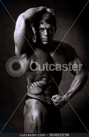 Muscled male model stock photo, Muscled male model posing in studio by Vadim