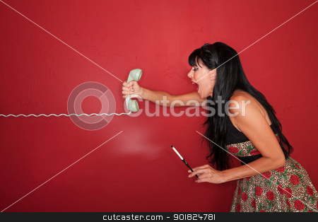 Woman Yells On Phone stock photo, Frustrated Caucasian woman yells on phone call over maroon background by Scott Griessel