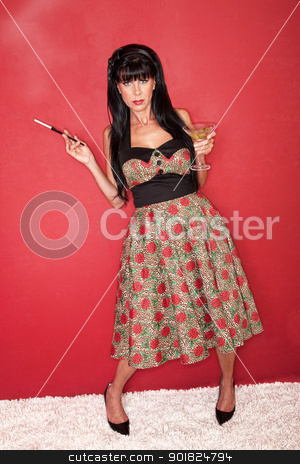 Drunk Woman stock photo, Drunk Caucasian woman stands with martini and cigarette over red background by Scott Griessel