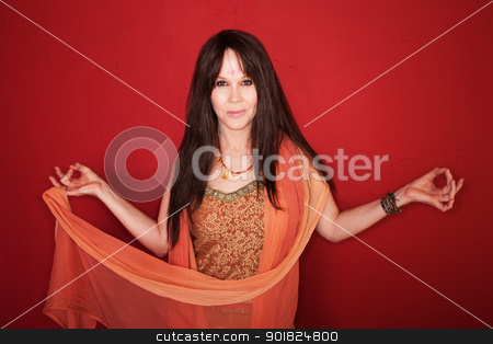 Woman With Raised Arms stock photo, Caucasian woman in Indian attire with raised arms over red background by Scott Griessel