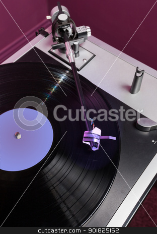 Vinyl analog record player cartridge and LP stock photo, Long Playing record LP on retro record player with tone arm and cartridge by Steven Heap