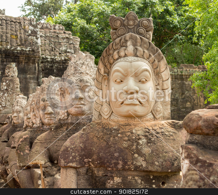 Demons line entrance to south gate angkor thom stock photo, South gate to angkor thom in Cambodia is lined with warriors and demons by Steven Heap
