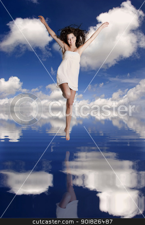 Girl jumping over the water stock photo, Beautiful and happy girl jumping over the water with her reflection by ikostudio