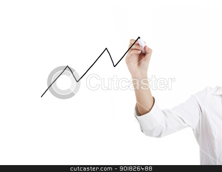Drawing a graphic chart stock photo, Female hand of a young businesswoman drawing a graphic chart by ikostudio