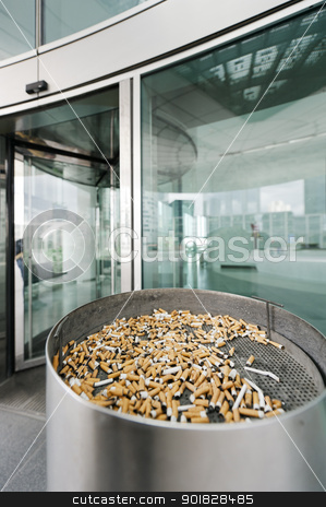 Outdoor street ashtray stock photo, Outdoor ashtray (smoking place) for the disposal of cigarettes before entering a modern building by ifeelstock