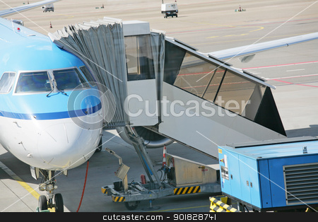 Airplane at an airport with passenger gangway  stock photo, Airplane at an airport with passenger gangway  by dacasdo