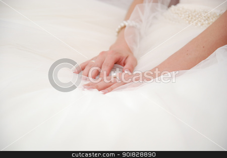 Hands of bride on a wedding white dress stock photo, Hands of bride on a wedding white dress.Pearls on a belt by Vadim