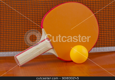 Ping Pong stock photo, Ping pong orange racket with yellow ball near the net by Fabio Alcini