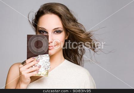 Chocolate loving brunette cutie. stock photo, Portrait of a sensual chocolate loving brunette cutie. by exvivo