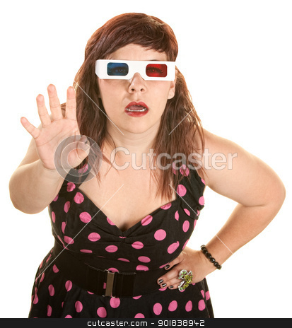 Lady in Pink Polka Dot Dress stock photo, Beautiful woman with 3D glasses reaching out over white background by Scott Griessel