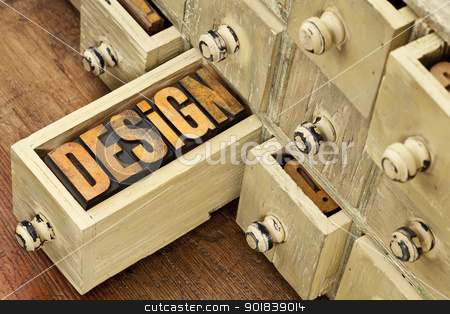 design word - concept in wood type stock photo, design concept - a word in vintage letterpress wood type and primitive rustic wooden apothecary drawer cabinet by Marek Uliasz